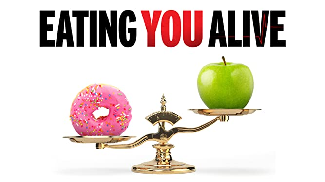 Movie poster for vegan movie eating you alive showing a classic weight scale with a doughnut and an apple with the apple raised up