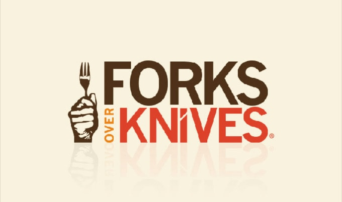 Vegan Movie poster of Forks Over Knives a documentary about a how a vegan diet can treat and reverse chronic diseases it shows a fist holding a fork